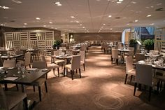 Elegant, spacious restaurant refit project, complete with bespoke wooden room divider.