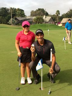 Izzy M. Pellot challenging 2014 Golf academy graduate Alex Johnson in a putting competition.