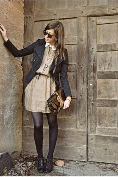 biker jacket over dress. tights.