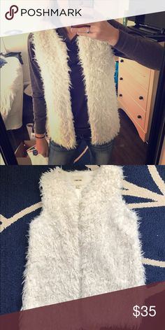 White faux fur fashion vest Very cute white furry vest. Fashionable and warm. This is a kids size xl but it fits perfectly like a xs/sm Jackets & Coats Vests