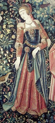 """EXCERPT: In the mid 1800s, a series of six related tapestries depicting the nobility in everyday pursuits was discovered in a French chateau. Subsequent studies have dated the series, now called """"La Tenture de la vie Seigneuriale"""" (scenes from lordly life), to the early 16th Century, approximately 1500-1520. This figure is from the tapestry known as """"La Promenade"""" (the walk)."""