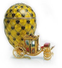"""Fabergé Coronation Egg, 1897, presented by Nicholas II to Czarina Alexandra Fyodorovna. Fabergé enclosed a jeweled """"surprise"""" fitted inside a velvet-lined compartment: a precise replica, under four inches long, of the eighteenth-century Imperial coach that carried Alexandra to her coronation in Moscow at the Uspensky Cathedral in May 1896."""