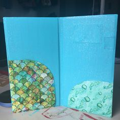 Inside of mermaid and jellyfish server book by Server Book Art