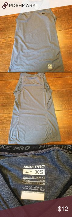 "Nike Pro Dri Fit V Neck Active Wear Yoga Top XS NIKE PRO DRI FIT Gray V Neck Top with Black Trim 84% Polyester, 16% Spandex Size XS Measures approximate 15"" across front bustline 25"" length  Very Good, Previously Worn Condition Nike Tops Tank Tops"