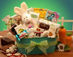 Ultimate Easter Selection    A pretty green spring planter bears the Ultimate Easter Selection of treats and goodies to all the little girls and boys on your Easter list! Moms and Dads will enjoy all the goodies delivered by this cute little bunny! Send the Ultimate Easter Selection to somebunny special today!