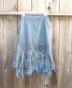 Lovely Upcycled Acid Wash Denim Skirt with Hand Dyed cotton and Lace ruffles. Hand beaded. Size : Small/ Medium ( waist is lower than waistline allowing some flexibility in size)  Waist : 13.5 this is lower than waist line Hip : 19.2  Length : 26 to 34