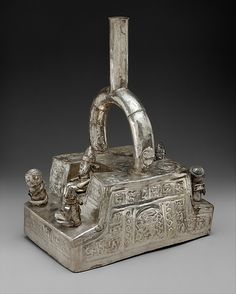 Bottle, Throne with Figures  Date:     14th–15th century Geography:     Peru Culture:     Chimú Medium:     Silver