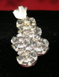 Handcast (in cuttlefish) Flower Pendant with Sterling Silver Heart Bail.  £20.00 plus P&P