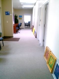 My paintings lined up in the hallway before hanging.