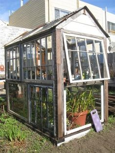 simple greenhouse and storage from old windows (via apartmenttherapy)