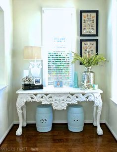 coastal foyer with framed shells and coral on stand httpwww
