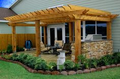Acid Stained Patio, Pergola, Custom Stone Outdoor BBQ, Landscaping, Houston