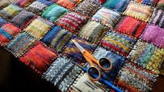 susis quilts: knitted baby blanket from sock wool remnants - pouches stuffed w/ fiberfill and sewn together.