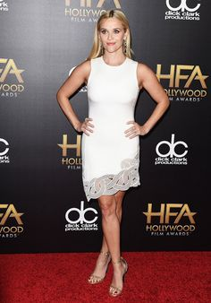 Reese Witherspoon looks classic on the red carpet in  white dress with a detailed hem