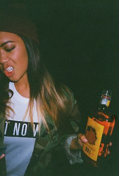 Ally) I was standing in the corner with a bottle of fireball. I had barely taken a drink. I was no where near drunk. I stand there looking around like a lost puppy. I look up and see you smile at me. I smile back and blush. You start walking my way.