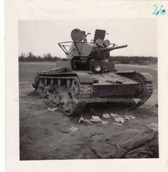Relatively rare version of T-26: modification of 1938 had conical turret but under-turret box with straight sides. This one still have an old under-turret box, but the turret itself seems to be of a later 1939 version