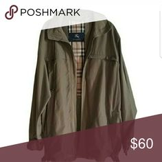 Burberry London Nova Check Coat Sz L Like new condition! This coat is well taken care of. No rips or stains. There is a hidden picket inside and 4 pockets outside. It is vented on the bottom. The nove check hood can be rolled and hidden. The coat can be used as a raincoat/windbreaker. Size Large Burberry Jackets & Coats