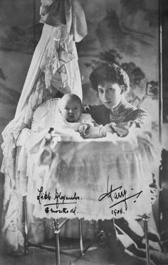 Photograph of Princess Maud (1869-1938), kneeling besides the cot in which the baby Prince Olav (1903-91) sits, aged eight months. Signed 'Alexander, 8 months, Harry 1904'.