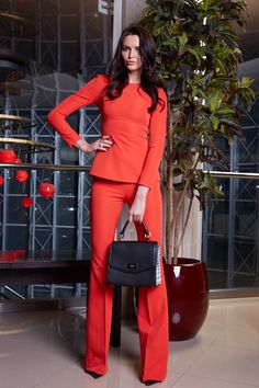 Woman business suit, red colour.