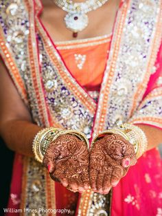 Wedding Ideas - WeddingWire Wedding Ideas - WeddingWire Project Wedding projectwedding Indian Weddings The bride opens her hands to show off her stunning hennaed palms and dazzling gold bangles. Wedding Songs, Wedding Ideas, Mehndi Photo, Indian Embroidery, Wedding Tattoos, Bridal Mehndi, Gold Bangles, Hand Henna, Indian Weddings