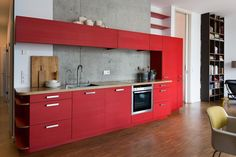 A Modern And Tasteful Berlin Apartment. Ohh…and a RED kitchen! – The Design Stash