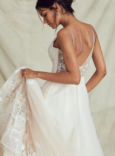 A sweet symphony of beauty and love, this stunning ombre floral embroidered wedding gown hits all the right notes. The bold melody of floral embroidery that floats along the hem of the tulle skirt harmonizes with the exquisite lace details of the bodice and deep-V back. The glissando from ivory into blush gives this light and slimming floral wedding gown a graceful rhythm that rocks worlds. Floral Wedding Gown, Wedding Gowns, Casual Work Outfits, Lace Back, Wedding Styles, Ball Gowns, Bride, Formal Dresses, Floral Embroidery