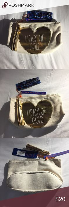 Heart of gold make up bag Natural canvas with gold heart make up bag. Brand new with tags. Never been used Violet Ray Bags Cosmetic Bags & Cases