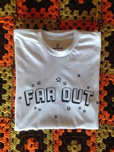 Far OutTee Available inWhite Sizes S, M, L 50% Polyester/ 50% Cotton Made and Printed in small batches in the USA
