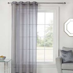 Fabricated with a woven texture, this grey sheer voile panel features an…