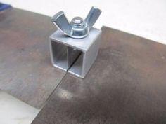 Butt Welding Clamp - Homemade butt welding clamp constructed from tubing, sheetmetal, bolt, and a wing nut.