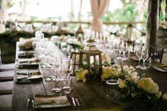 Wooden dinner tables with yellow small flowers