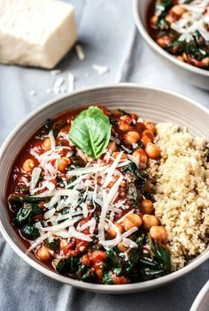 Easy, gluten free, vegetarian and vegan friendly tomato basil chickpeas and spinach served over nutty quinoa for a quick, healthy, budget friendly weeknight meal.