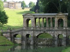 """Palladian Bridge & Prior Park Landscape Garden is an 18th-century landscape garden, designed by the poet Alexander Pope and the landscape gardener Capability Brown and now owned by the National Trust. It is south of Bath, Somerset, by Ralph Allen Drive and 3/4 mile from the Kennet and Avon canal path. The garden was influential in defining the style of garden known as the """"English garden"""" in continental Europe"""