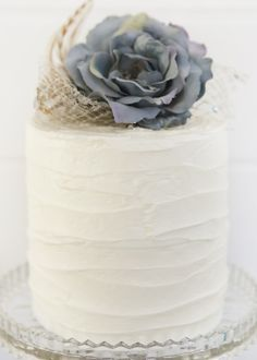 Small and simple grey flower wedding cake.
