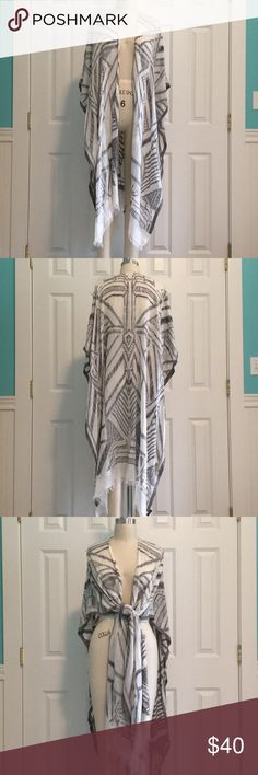 Anthropologie Boho Kimono Gray and white boho beach kimono/wrap scarf in tribal print. Can be worn as a jacket or beach cover up. Worn once. Perfect condition! Anthropologie Accessories Scarves & Wraps