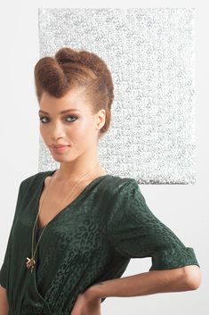 "4 Fresh Holiday 'Dos For Natural Hair #refinery29  http://www.refinery29.com/57723#slide1  The New ""I Love Lucy""   We love the classic beauty of this rolled, twisted style. Daytime, nighttime — well, anytime, really. Swoop it up, step on out. Topshop leopard green jumpsuit, $116, available at Topshop; Jennifer Fisher gold chain, $340, available at Jennifer Fisher; Jennifer Fisher charms, $650 to $1,200, available at Jennifer Fisher."