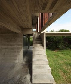 rustic concrete + weathered wood -- slit openings