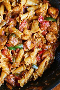 ThisChicken Fajita Pasta is hands down one of our all-time favorite meals. It's loaded with crispy chicken, fresh veggies, and wonderfully spicy, creamy sauce. It's utterly delicious. And you seriously won't even believe howridiculously quick and easy it is to make! It's so, so good. Creamy, decadent deliciousness! Here's how you make it. Start by …