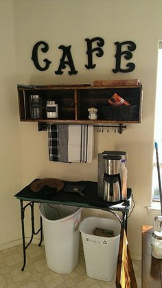DIY Coffee bar shelf made out of pallets and scrap wood. Love this! Hooks are to hang coffee cups.