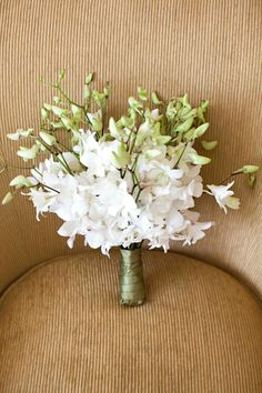 Stunning Wedding Bouquet Showcasing: White Dendrobium Orchids + Buds Hand Tied With Sage Green Satin Ribbon