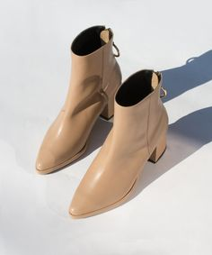 After launching in Seol in 2010, Reike Nen has since become a cult favorite known for its classic lines and contemporary shapes with a twist. Add these block heeled ankle beauties to your fall wardrobe now.