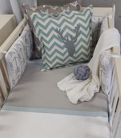 For a simple Woodland Theme in Grey with a touch of Blue, this combination is perfect for any little Boys Nursery!