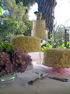 DIY wedding cake    ..different flavored cakes on stands - great way to add different heights with a variety of looks (but one overall theme).