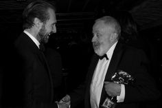 Mike Leigh, awarded a Bafta fellowship, is congratulated by Ralph Fiennes