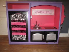 Play kitchen - We made this for our little one's birthday and it is a huge hit! DIY play kitchen made from an entertainment center...it is a project I will never forget doing with my husband and now watching our kids play with it... priceless! Thanks pinterest for the idea :)