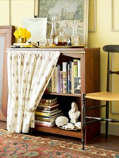 Skirted Book Storage:   A ready-to-assemble bookcase becomes an attractive focal point when draped with a cafe curtain. Attach a lightweight curtain rod to the top of the bookcase; add the fabric you fancy.