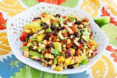 Avocado, Corn and Mango Salad – Good enough with chips and margaritas, or the perfect summer salad/salsa side dish! | thecomfortofcooking.com