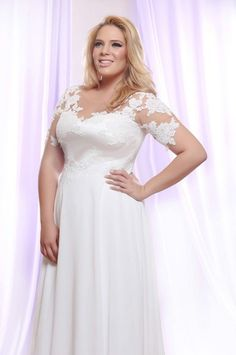 This plus size wedding dress with pearl beaded lace is just one of the options we have for the fuller figured curvy bride. See more in our main catalog.