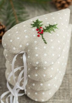 Cross-stitch embroidered heart ornaments.