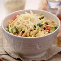 Linguine with Fresh Tomatoes and Asparagus - Easy, colorful and truly delicious, this pasta dish is an excellent choice for entertaining or when you'd like a fresh garden-inspired family meal.